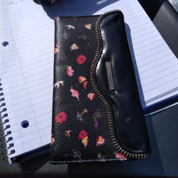 A cute Rebecca Minkoff iphone wallet phone case